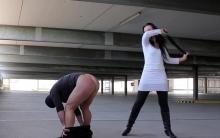 Brutal spanking in public garage